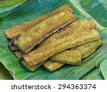 Small photo of Damocles tree, Oroxylum Indicum, boiled, grilled, then placed on a banana leaf to supply the market.