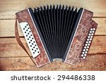 Accordion On Wood Background
