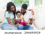 happy couple with their baby... | Shutterstock . vector #294495929