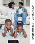 happy siblings lying on the... | Shutterstock . vector #294504224
