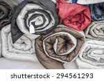 rolled quilts and blankets of... | Shutterstock . vector #294561293