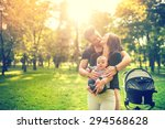 Happy Father Hugging Mother An...