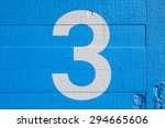 the number 3 painted on a blue... | Shutterstock . vector #294665606