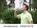 handsome man drinking water in... | Shutterstock . vector #294676178