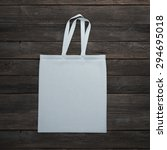 white bag on the wooden table | Shutterstock . vector #294695018