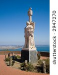 A statue of the explorer Cabrillo looks on toward San Diego - stock photo