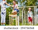 happy girl jumping over... | Shutterstock . vector #294736568
