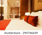 Stock photo view of a luxury hotel room with king bed and ensuite 294746639