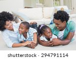 happy family lying on the floor ... | Shutterstock . vector #294791114