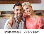 happy couple cuddling on the... | Shutterstock . vector #294791324