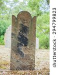 Small photo of Port Arthur,Tasmania, Australia - January 15, 2015: Old tombstone in the Isle of the Dead hystoric site, used as the graveyard for the penal settlement of Port Arthur from 1833 to 1877
