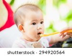 mother feeding her 7 months... | Shutterstock . vector #294920564