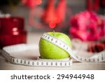Green Apple With A Measuring...