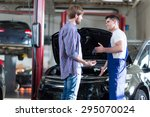mechanic giving client keys to... | Shutterstock . vector #295070024