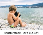 Little Photographer With Big...