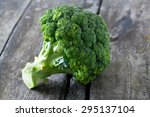 fresh broccoli on wooden table | Shutterstock . vector #295137104