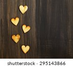 Wooden Hearts On A Black...