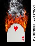 Small photo of Playing card with fire and smoke, isolated on white - Ace of hearts