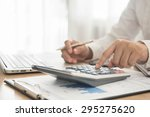businessman using a calculator... | Shutterstock . vector #295275620