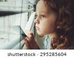sad little girl looking out the ... | Shutterstock . vector #295285604