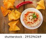 hummus with nachos on  wooden... | Shutterstock . vector #295296269