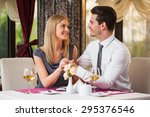 happy couple having great time... | Shutterstock . vector #295376546