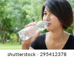 asian young girl drink water in ... | Shutterstock . vector #295412378