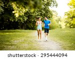 young couple running | Shutterstock . vector #295444094