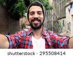 Young Latin Man Taking A Selfi...