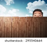 A Man Head Behind Wooden Fence...