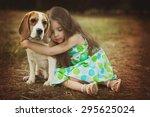 little girl is hugging  dog... | Shutterstock . vector #295625024