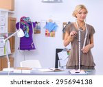 young fashion designer working... | Shutterstock . vector #295694138