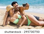 happy couple relaxing on beach... | Shutterstock . vector #295730750