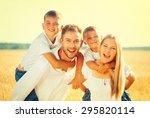 Happy Young Family With Two...