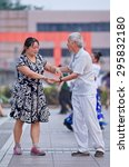 Small photo of BEIJING-JULY 10, 2015. Collective square dancing. Its vast popularity has also a drawback, due to the nuisance the Chinese government will launch soon national standards and regulations to guide it.