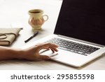 woman using laptop and on her... | Shutterstock . vector #295855598