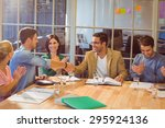group of young colleagues using ... | Shutterstock . vector #295924136