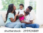 happy parents with baby girl on ... | Shutterstock . vector #295924889