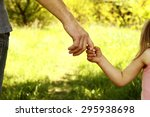 a the parent holding the hand...   Shutterstock . vector #295938698