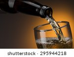 pouring beer into glass | Shutterstock . vector #295944218
