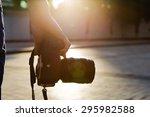 photographer holding a camera... | Shutterstock . vector #295982588