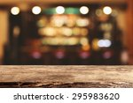 Small photo of blurred background of bar and dark brown desk space of retro wood