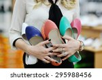 pretty girl holding a lot of... | Shutterstock . vector #295988456