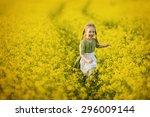 a little pretty girl in a green ... | Shutterstock . vector #296009144
