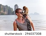 Young Man With Funny Monkey...