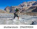 Hiker Crossing Mountain River