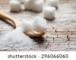 White Sugar In Wood Spoon On...