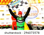 Milwaukee Wisconsin, USA - July 12, 2015: Verizon Indycar Series Indyfest ABC 250 at the Milwaukee Mile. Sebastien Bourdais of Le Mans France, winner of the race, celebrates in victory circle. - stock photo