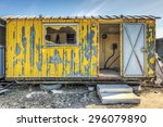 Dilapidated Yellow Work Site Hut