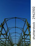 old industrial steel structure against blue sky - stock photo